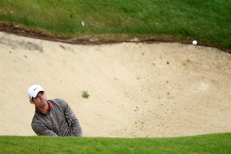 VIRGINIA WATER, ENGLAND - MAY 26:  Paul Casey of England hits from a bunker on the 18th hole during the first round of the BMW PGA Championship at Wentworth Club on May 26, 2011 in Virginia Water, England.  (Photo by Warren Little/Getty Images)