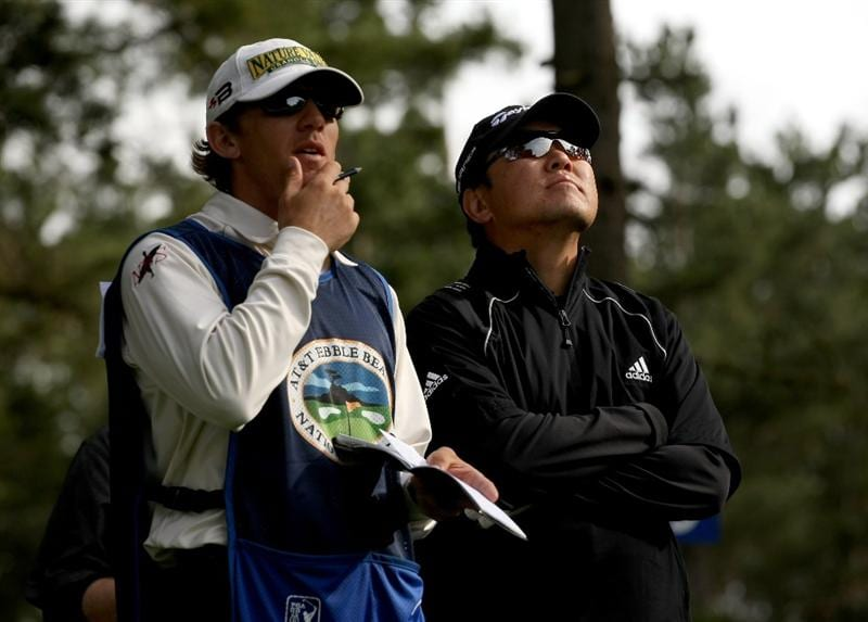 PEBBLE BEACH, CA - FEBRUARY 14: Charlie Wi and his caddy consider his tee shot on the fifth hole on Poppy Hills Golf Course during the third round of the the AT&T Pebble Beach National Pro-Am on February 14, 2009 in Pebble Beach, California. (Photo by Stephen Dunn/Getty Images)