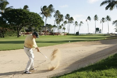 Paul Goydos hits his ball out of fairway bunker onto the 16th green during the third round of the Sony Open in Hawaii held at Waialae Country Club in Honolulu, Hawaii, on January 13, 2007. Photo by Marco Garcia/WireImage.com