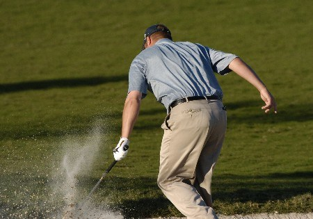 Brett Wetterich slams his club into the sand after a short shot  on the 16th hole during  third  round competition at the 2005 Honda Classic March 12, 2005 in Palm Beach Gardens, Florida. Wetterich shot a 72 to tie for the lead.