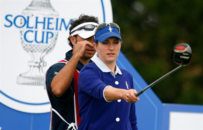 SUGAR GROVE, IL - AUGUST 21:  Brittany Lang of the U.S. Team lines up her tee shot on the second hole with her brother/caddie Luke during the friday morning fourball matches at the 2009 Solheim Cup at Rich Harvest Farms on August 21, 2009 in Sugar Grove, Illinois.  (Photo by Scott Halleran/Getty Images)