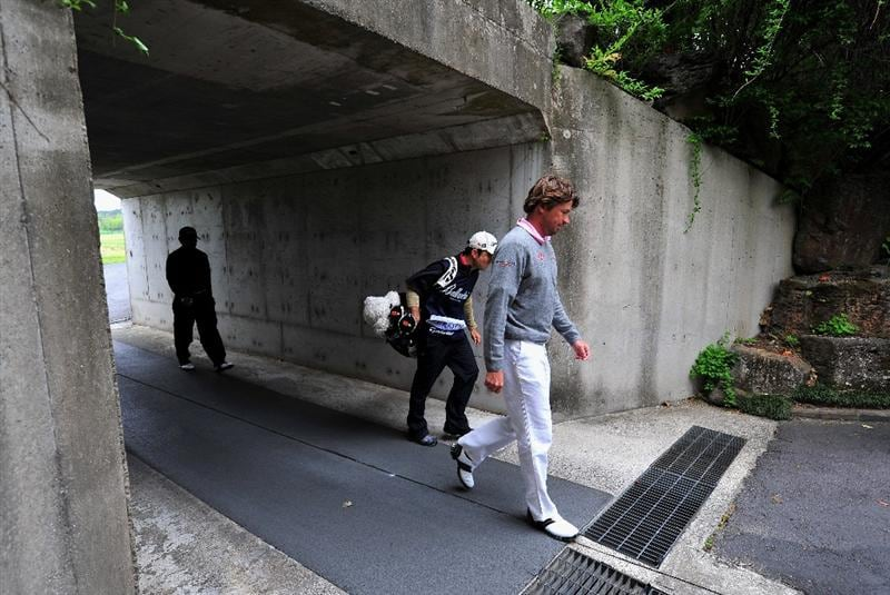 JEJU, SOUTH KOREA - APRIL 24:  Robert - Jan Derksen of The Netherlands walks through a tunnel during the second round of the Ballantine's Championship at Pinx Golf Club on April 24, 2009 in Jeju, South Korea.  (Photo by Stuart Franklin/Getty Images)
