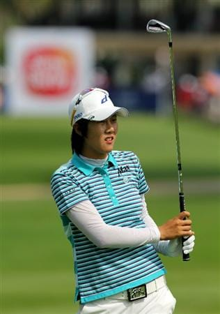 KUALA LUMPUR, MALAYSIA - OCTOBER 23:  Song-Hee Kim of Korea Republic watches her 2nd shot on the 1st hole during Round Two of the Sime Darby LPGA at the Kuala Lumpur Golf and Country Club on October 23, 2010 in Kuala Lumpur, Malaysia. (Photo by Stanley Chou/Getty Images)