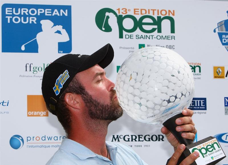 ST OMER, FRANCE - JUNE 21:  Christian Nilsson of Sweden poses with his trophy after winning the Open de St Omer at the AA St Omer Golf Club on June 21, 2009 in St Omer, France.  (Photo by Ryan Pierse/Getty Images)