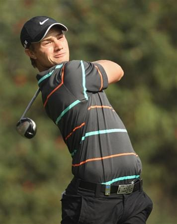 NEW DELHI, INDIA - FEBRUARY 14:  Oliver Fisher of England plays a shot during the Final Round of the Avantha Masters held at The DLF Golf and Country Club on February 14, 2010 in New Delhi, India.  (Photo by Ian Walton/Getty Images)
