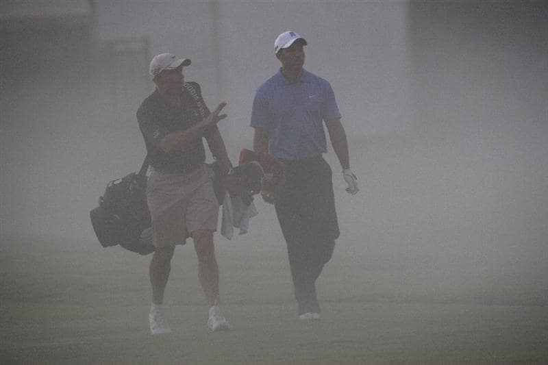 DORAL, FL - MARCH 11:  Tiger Woods of the USA walks with his caddie Steve Williams of New Zealand  from the 1st tee in the early morning mist during the final day of practice for the World Golf Championships-CA Championship at the Doral Golf Resort & Spa on March 11, 2009 in Miami, Florida  (Photo by David Cannon/Getty Images)