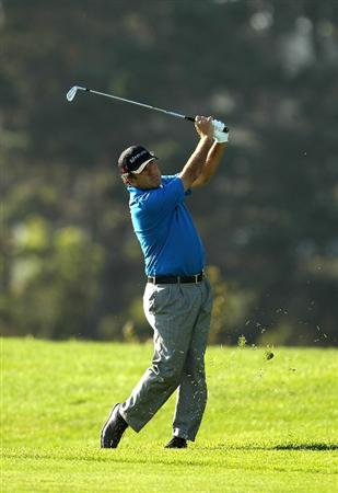 SAN FRANCISCO - NOVEMBER 06:  David Frost hits his second shot on the 18th hole during round 3 of the Charles Schwab Cup Championship at Harding Park Golf Course on November 6, 2010 in San Francisco, California.  (Photo by Ezra Shaw/Getty Images)