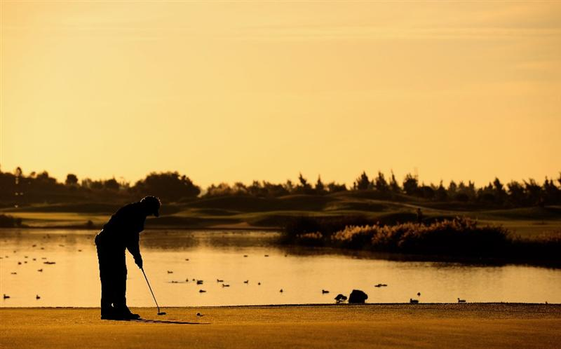 VILAMOURA, PORTUGAL - OCTOBER 15:  Darren Clarke of Northern Ireland putting on the 11th hole during the first round of the Portugal Masters at the Oceanico Victoria Golf Course on October 15, 2009 in Vilamoura, Portugal.  (Photo by Stuart Franklin/Getty Images)