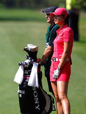 GUADALAJARA, MEXICO - NOVEMBER 15:  Michelle Wie of the United States and her caddie Brenden Woolley (L) wait to play her shot out of the sand trap on the third hole during the final round of the Lorena Ochoa Invitational Presented by Banamex and Corona at Guadalajara Country Club on November 15, 2009 in Guadalajara, Mexico.  (Photo by Kevin C. Cox/Getty Images)