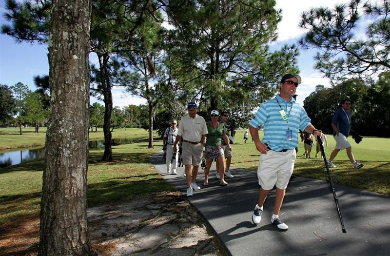 LAKE BUENA VISTA, FL - NOVEMBER 9:  D.J. Gregory, who has cerebral palsy, walks along the first hole, during the final round at the Children's Miracle Network Classic at Disney Magnolia golf course November 9, 2008 in Lake Buena Vista, Florida. Gregory has been walking every hole on every tournament day this year. His final walk will occur today as he walks up his final 18th hole on the Magnolia course.(Photo by Marc Serota/Getty Images)