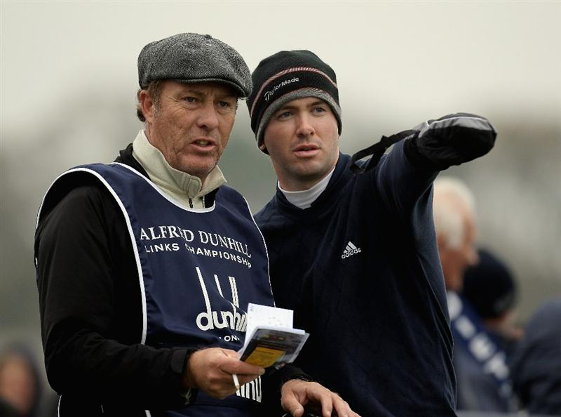 ST ANDREWS, SCOTLAND - OCTOBER 10:  Martin Laird of England with his caddie on the 18th tee during the final round of The Alfred Dunhill Links Championship at The Old Course on October 10, 2010 in St Andrews, Scotland.  (Photo by Ross Kinnaird/Getty Images).