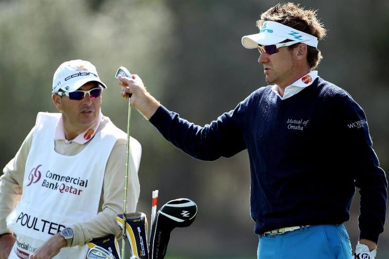DOHA, QATAR - JANUARY 27:  Ian Poulter of England waits with his caddie Terry Mundy on the 12th hole during the Pro Am prior to the start of the Commercialbank Qatar Masters at Doha Golf Club on January 27, 2010 in Doha, Qatar.  (Photo by Andrew Redington/Getty Images)