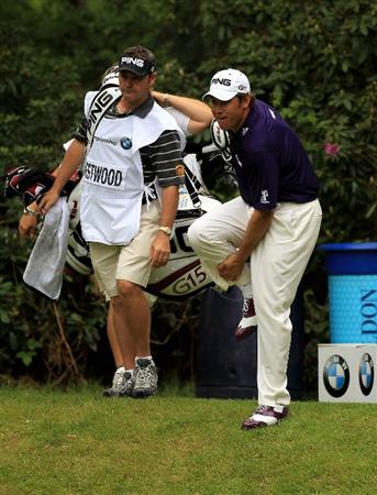 VIRGINIA WATER, ENGLAND - MAY 20:  Lee Westwood of England holds his leg after kicking the tee box on the 10th hole following a poor tee shot during the first round of the BMW PGA Championship on the West Course at Wentworth on May 20, 2010 in Virginia Water, England.  (Photo by Warren Little/Getty Images)