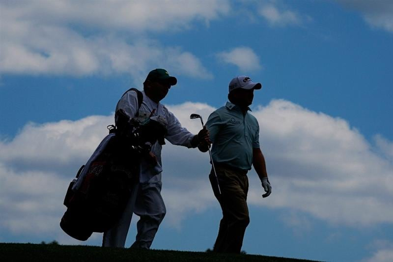 AUGUSTA, GA - APRIL 11:  Graeme McDowell of Northern Ireland walks off the fourth tee with his caddie Ken Comboy during the third round of the 2009 Masters Tournament at Augusta National Golf Club on April 11, 2009 in Augusta, Georgia.  (Photo by Jamie Squire/Getty Images)