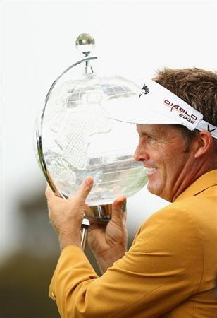 MELBOURNE, AUSTRALIA - NOVEMBER 14:  Stuart Appleby poses with the trophy after winning the Australian Masters at The Victoria Golf Club on November 14, 2010 in Melbourne, Australia.  (Photo by Ryan Pierse/Getty Images)