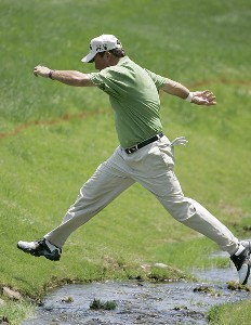 Olin Browne jumps over a stream on the 18th hole to check the position of his ball during the first round the 2006 Wachovia Championship at the Quail Hollow Club in Charlotte, North Carolina on May 4, 2006. Photo by Chris Condon/PGA TOURPhoto by Chris Condon/PGA TOUR