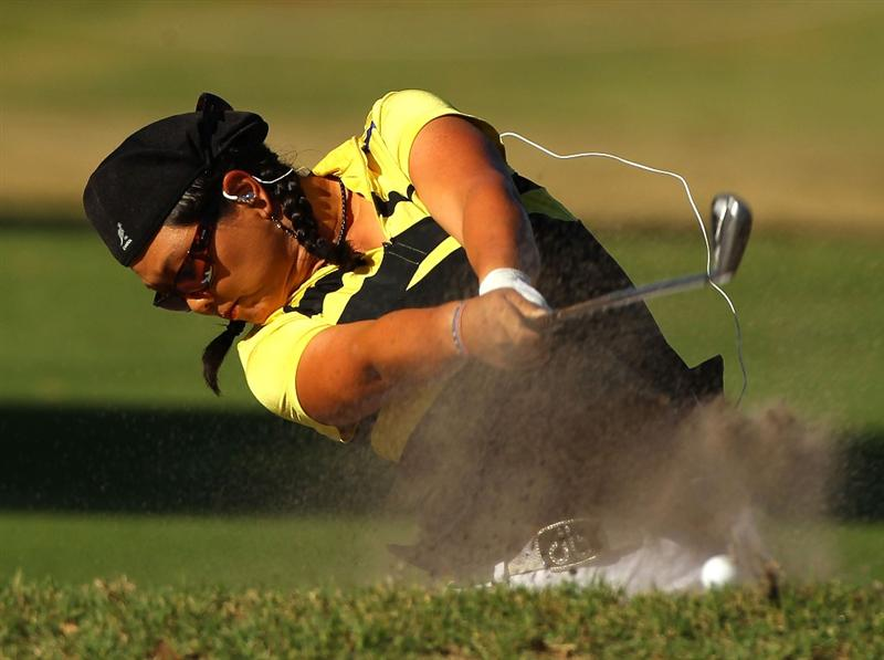 MELBOURNE, AUSTRALIA - MARCH 11:  Christina Kim of the USA hits a bunker shot on the 13th hole during round one of the 2010 Women's Australian Open at The Commonwealth Golf Club on March 11, 2010 in Melbourne, Australia.  (Photo by Mark Dadswell/Getty Images)