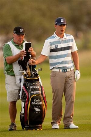 SAN ANTONIO, TX - APRIL 15: Kevin Chappell stands with his golf bag during the second round of the Valero Texas Open at the AT&T Oaks Course at TPC San Antonio on April 15, 2011 in San Antonio, Texas. (Photo by Darren Carroll/Getty Images)
