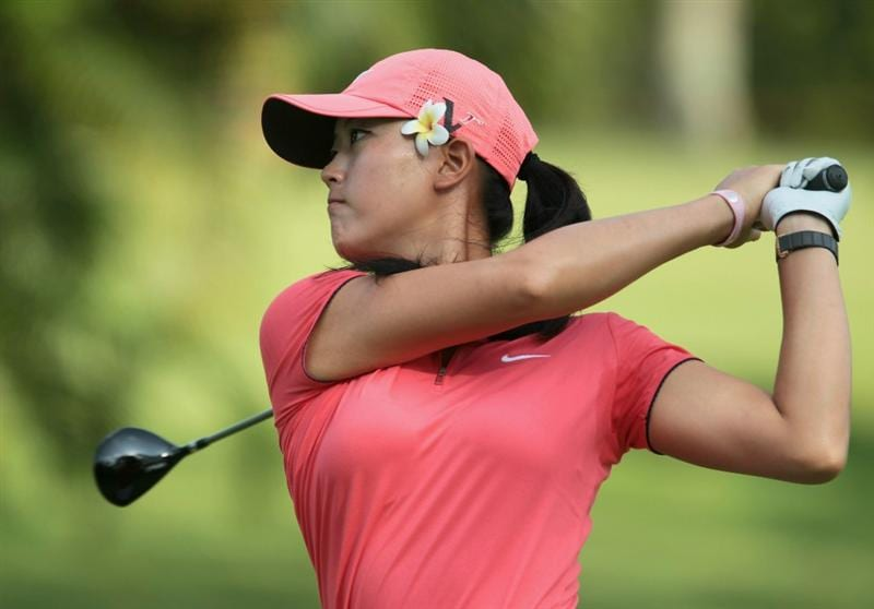 SINGAPORE - FEBRUARY 27:  Michelle Wie of the USA hits her second shot on the 14th hole during the final round of the HSBC Women's Champions 2011 at the Tanah Merah Country Club on February 27, 2011 in Singapore, Singapore.  (Photo by Scott Halleran/Getty Images)