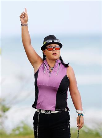 MONTEGO BAY, JAMAICA - APRIL 15:  Christina Kim of the United States calls for a rules official on the sixth green during the first round of The Mojo 6 Jamaica LPGA Invitational at Cinnamon Hill Golf Course on April 15, 2010 in Montego Bay, Jamaica.  (Photo by Kevin C. Cox/Getty Images)