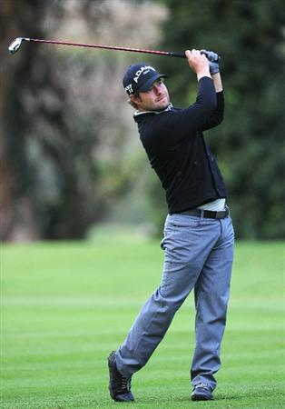 PACIFIC PALISADES, CA - FEBRUARY 18:  Ryan Moore plays his approach shot on the 11th hole during the second round of the Northern Trust Open at Riviera Country Club on February 18, 2011 in Pacific Palisades, California.  (Photo by Stuart Franklin/Getty Images)