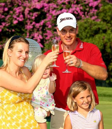 SUN CITY, SOUTH AFRICA - DECEMBER 07:  Henrik Stenson of Sweden poses with his wife, Emma and baby daughter Lisa after the final round of the Nedbank Golf Challenge at the Gary Player Country Club on December 7, 2008 in Sun City, South Africa.  (Photo by Richard Heathcote/Getty Images)