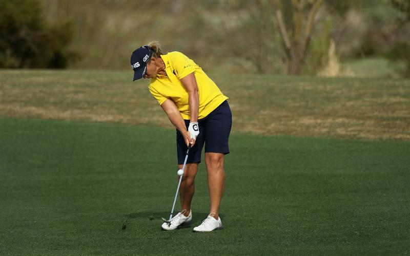 PHOENIX, AZ - MARCH 18:  Angela Stanford hits her second shot on the 16th hole during the first round of the RR Donnelley LPGA Founders Cup at Wildfire Golf Club on March 18, 2011 in Phoenix, Arizona.  (Photo by Stephen Dunn/Getty Images)