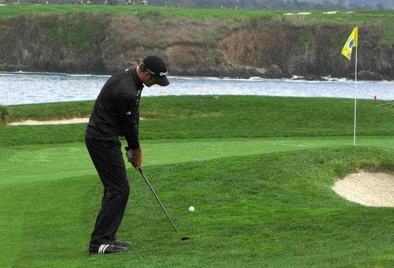 PEBBLE BEACH, CA - FEBRUARY 12: Dustin Johnson chips onto the green on the 17th hole during the first round of the the AT&T Pebble Beach National Pro-Am on Pebble Beach Golf Links on February 12, 2009 in Pebble Beach, California. (Photo by Stephen Dunn/Getty Images)