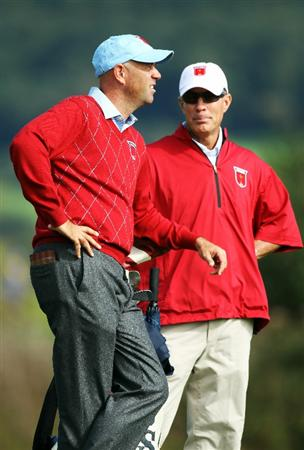 NEWPORT, WALES - SEPTEMBER 28:  Stewart Cink of the USA looks on with caddie Frank Williams during a practice round prior to the 2010 Ryder Cup at the Celtic Manor Resort on September 28, 2010 in Newport, Wales.  (Photo by Andy Lyons/Getty Images)