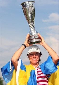 EVIAN, FRANCE - JULY 27:  Helen Alfredsson of Sweden poses with the trophy after winning the Evian Masters at the Evian Masters Golf Club on July 27, 2008 in Evian, France.  (Photo by Andrew Redington/Getty Images)