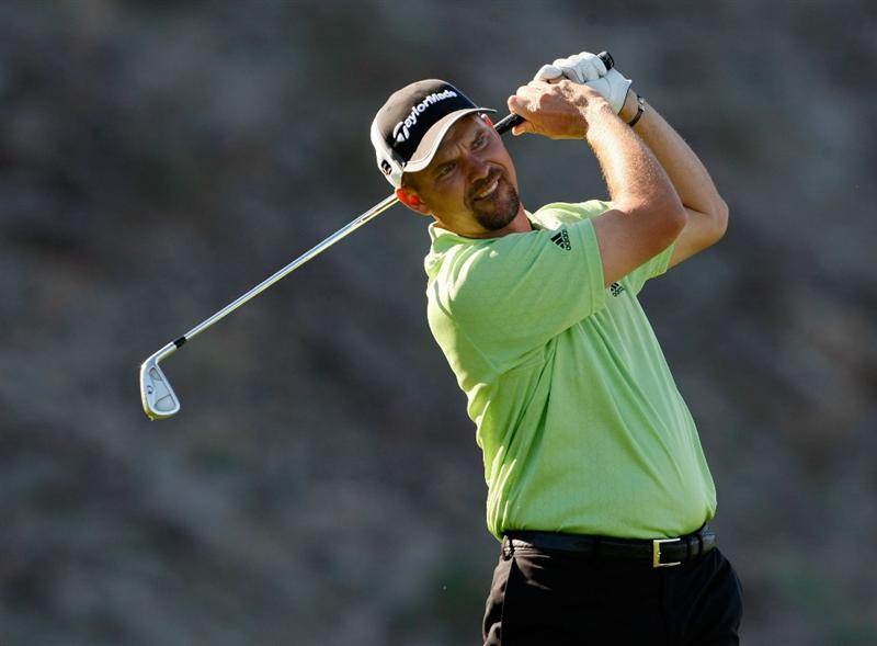 LA QUINTA, CA - JANUARY 24:  Cliff Kresge hits a tee shot on the eighth hole during the fourth round of the Bob Hope Chrysler Classic at the Silver Rock Resort on January 24, 2009 in La Quinta, California.  (Photo by Jeff Gross/Getty Images)