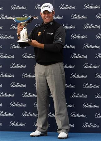 ICHEON, SOUTH KOREA - MAY 01:  Lee Westwood of England poses with the trophy after winning the Ballantine's Championship at Blackstone Golf Club on May 1, 2011 in Icheon, South Korea.  (Photo by Andrew Redington/Getty Images)