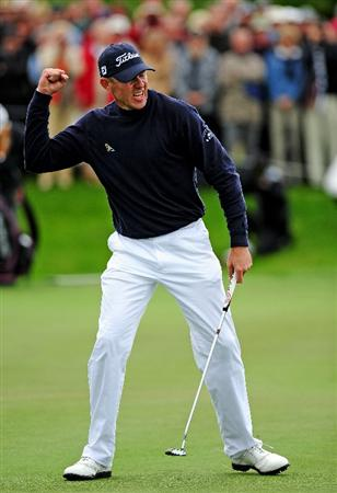 COLOGNE, GERMANY - SEPTEMBER 13: James Kingston of South Africa celebrates sinking the winning putt on the 18th hole during the playoff against Ander Hansen of Denmark during the final round of The Mercedes-Benz Championship at The Gut Larchenhof Golf Club on September 13, 2009 in Cologne, Germany.  (Photo by Stuart Franklin/Getty Images)
