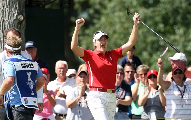 SUGAR GROVE, IL - AUGUST 23: Brittany Laing of the USA celebrates her win over Laura Davies of England at the 18th hole during the Sunday singles matches at the 2009 Solheim Cup Matches, at the Rich Harvest Farms Golf Club on August 23, 2009 in Sugar Grove, Ilinois (Photo by David Cannon/Getty Images)