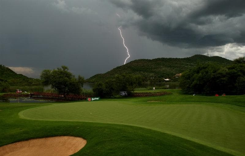 SUN CITY, SOUTH AFRICA - DECEMBER 05:  A view of the 16th green as lightning strikes the hills behind and storms bring a halt to play during the second round of the Nedbank Golf Challenge at the Gary Player Country Club on December 5, 2008 in Sun City, South Africa.  (Photo by Richard Heathcote/Getty Images)
