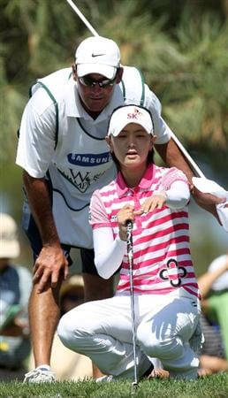 LA JOLLA, CA - SEPTEMBER 20: Na Yeon Choi of South Korea lines up an eagle putt with caddie on the 6th hole during the final round of the LPGA Samsung World Championship on September 20, 2009 at Torrey Pines Golf Course in La Jolla, California.  (Photo By Donald Miralle/Getty Images)