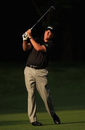 CHARLOTTE, NC - MAY 06:  Phil Mickelson watches a shot on the 12th hole during the second round of the Wells Fargo Championship at Quail Hollow Club on May 6, 2011 in Charlotte, North Carolina.  (Photo by Streeter Lecka/Getty Images)