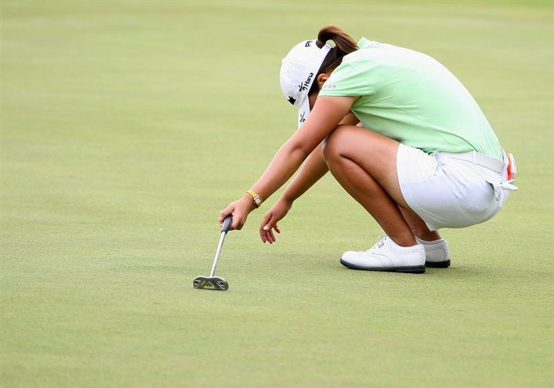 SPRINGFIELD, IL - JUNE 07:  In-Kyung Kim of South Korea reacts after missing a birdie putt on the 18th hole green during the fourth round of the LPGA State Farm Classic golf tournament at Panther Creek Country Club on June 7, 2009 in Springfield, Illinois.  (Photo by Christian Petersen/Getty Images)