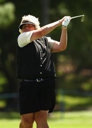 GOLD COAST, AUSTRALIA - MARCH 04: Laura Davies of England plays an iron shot on the 8th hole during round one of the 2010 ANZ Ladies Masters at Royal Pines Resort on March 4, 2010 in Gold Coast, Australia.  (Photo by Ryan Pierse/Getty Images)