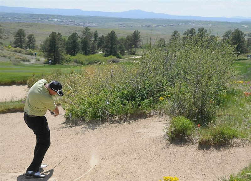 PARKER, CO - MAY 27:   Tom Lehman hits out of the fairway bunker on the 1st hole during the first round of the Senior PGA Championship at the Colorado Golf Club  on May 27, 2010 in Parker, Colorado.  (Photo by Marc Feldman/Getty Images)