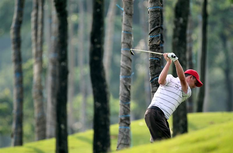 KUALA LUMPUR, MALAYSIA - MARCH 04: Peter Lawrie of Ireland plays his second shot on the par four 6th hole during the first round of the Maybank Malaysia Open at the Kuala Lumpur Golf & Country on March 4, 2010 in Kuala Lumpur, Malaysia.  (Photo by Ross Kinnaird/Getty Images)