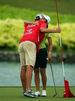 SINGAPORE - MARCH 02:  Lorena Ochoa of Mexico celebrates with her caddie on the 18th green after winning the HSBC Women's Champions at Tanah Merah Country Club on March 2, 2008 in Singapore.  (Photo by Andrew Redington/Getty Images)