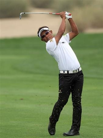 DUBAI, UNITED ARAB EMIRATES - FEBRUARY 06:  Thongchai Jaidee of Thailand plays his second shot at the 16th hole during the third round of the 2010 Omega Dubai Desert Classic on the Majilis Course at the Emirates Golf Club on February 6, 2010 in Dubai, United Arab Emirates.  (Photo by David Cannon/Getty Images)