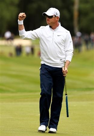 VIRGINIA WATER, ENGLAND - MAY 29:  Simon Dyson of England celebrates a birdie putt on the 11th green during the final round of the BMW PGA Championship  at the Wentworth Club on May 29, 2011 in Virginia Water, England.  (Photo by Richard Heathcote/Getty Images)