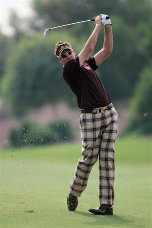 DUBAI, UNITED ARAB EMIRATES - NOVEMBER 23:  Ian Poulter of England in action during the Pro Am prior to the start of the Dubai World Championship on the Earth Course, Jumeirah Golf Estates on November 23, 2010 in Dubai, United Arab Emirates.  (Photo by David Cannon/Getty Images)