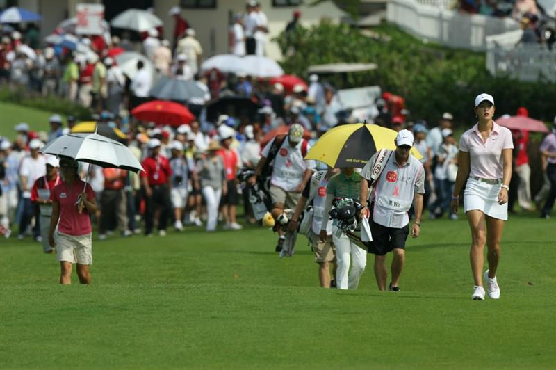 KUALA LUMPUR, MALAYSIA - OCTOBER 23: Michelle Wie of USA leads the pack on the 1st hole during Round Two of the Sime Darby LPGA on October 23, 2010 at the Kuala Lumpur Golf and Country Club in Kuala Lumpur, Malaysia. (Photo by Stanley Chou/Getty Images)