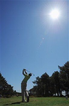 CASCAIS, PORTUGAL - APRIL 04:  Rory McIlroy of Northern Ireland plays his tee shot on the third hole during the second round of The Estoril Open de Portugal The Oitavos Dunes Golf Course on April 4, 2008 in Cascais, Portugal.  (Photo by Stuart Franklin/Getty Images)