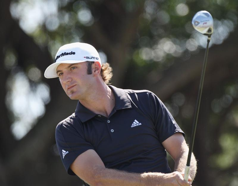 DORAL, FL - MARCH 13:  Dustin Johnson watches his tee shot on the fifth hole during the final round of the 2011 WGC- Cadillac Championship at the TPC Blue Monster at the Doral Golf Resort and Spa on March 13, 2011 in Doral, Florida.  (Photo by Sam Greenwood/Getty Images)