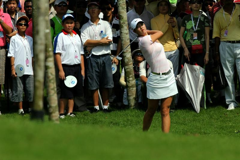 KUALA LUMPUR, MALAYSIA - OCTOBER 23 : Michelle Wie of USA plays her 2nd shot out of the rough on the 3rd hole during Round Two of the Sime Darby LPGA on October 23, 2010 at the Kuala Lumpur Golf and Country Club in Kuala Lumpur, Malaysia. (Photo by Stanley Chou/Getty Images)