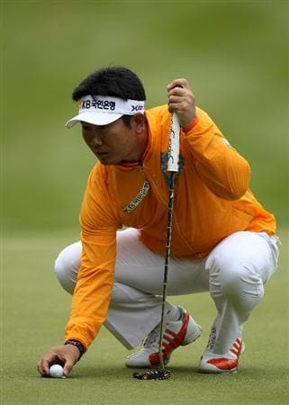 VIRGINIA WATER, ENGLAND - MAY 28:  Y.E. Yang of Korea lines up a putt on the 1st green during the third round of the BMW PGA Championship at the Wentworth Club on May 28, 2011 in Virginia Water, England.  (Photo by Warren Little/Getty Images)